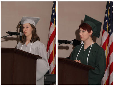 Lake Campus Graduates Andrea Barga, left and Callie Reymann, right address their fellow graduate at the 2017 Lake Campus Commencement Ceremony.